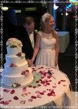 Joseph and Pamela cutting the the cake.